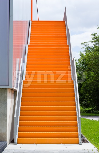 Orange steel stairway Stock Photo