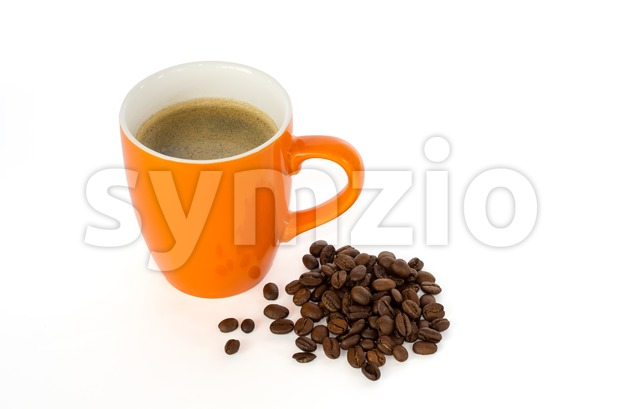 Coffee in a mug and coffee beans Stock Photo