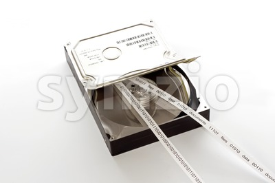 Open hard drive and a straight tape of data Stock Photo