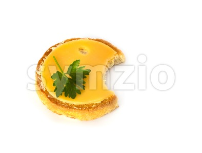 Round biscuit with cheese with a bite out Stock Photo