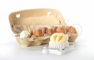 Egg slicer with a box of eggs Stock Photo