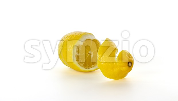 Half peeled and sliced lemon Stock Photo