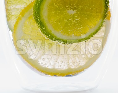 Lemon and lime in sparkling water Stock Photo