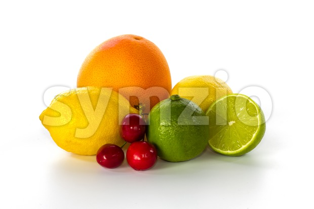 Grapefruit, lemons, limes and cherries still life Stock Photo