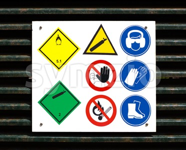 Hazard and safety symbols on door Stock Photo