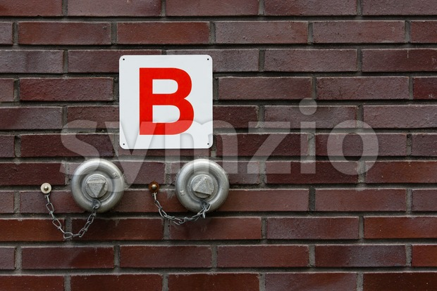 Wall mounted fire hydrant for emergency use Stock Photo