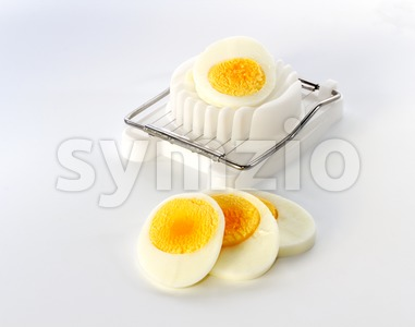 An egg slicer and sliced egg Stock Photo