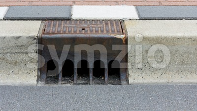 Sidewalk with street drain Stock Photo