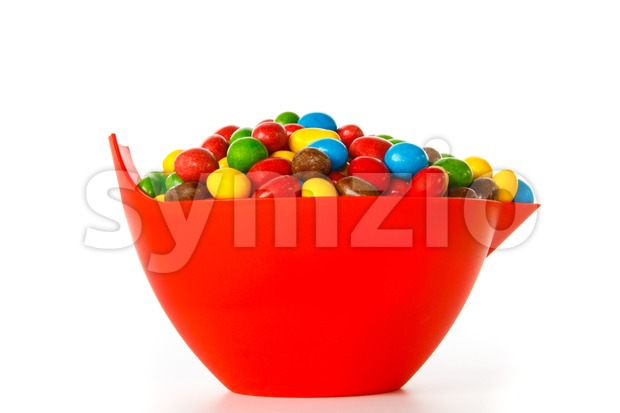 Bowl with colorful chocolate sweets Stock Photo
