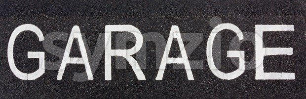 Garage sign painted on the road Stock Photo