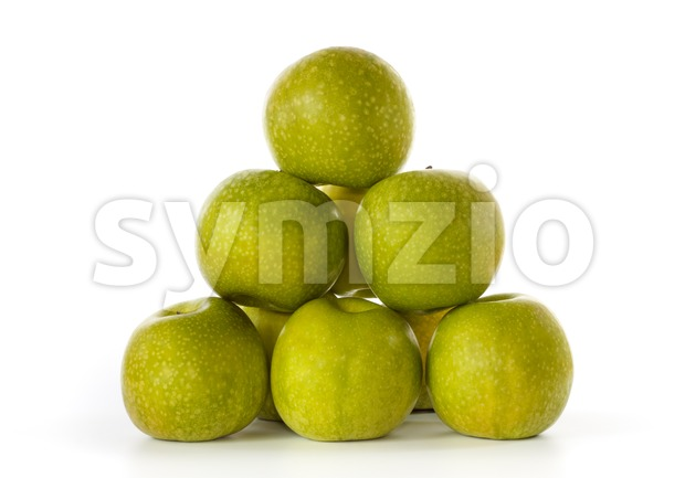 Stack of Granny Smith apples against a white background