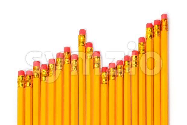 Rising graph of pencils against white background Stock Photo