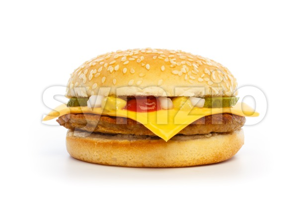 Hamburger with cheese, pickles, onion and sauce Stock Photo