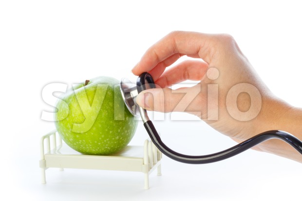 Apple receives care in hospital bed Stock Photo