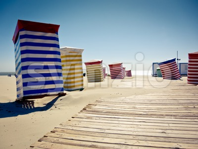 Colorful beach chairs on sunny sand Stock Photo