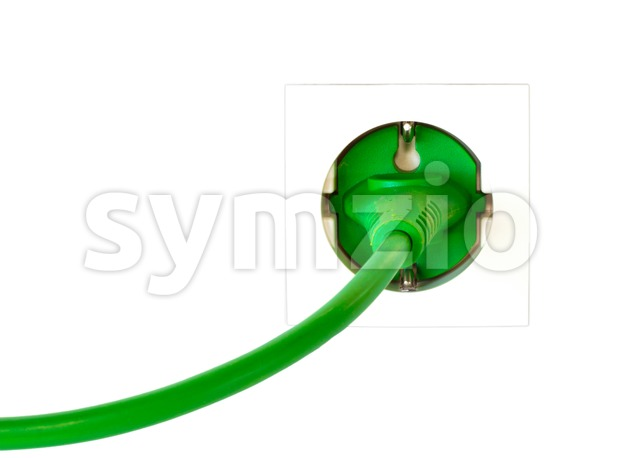 Green power plug in simple wall outlet Stock Photo