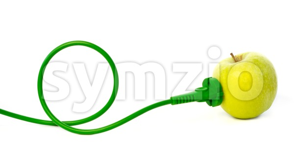 Green power cord plugged into apple outlet Stock Photo