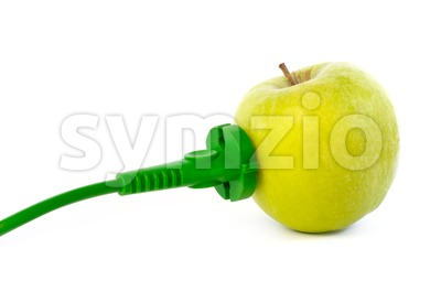 Green power cable attached to apple outlet Stock Photo