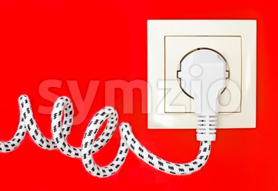 Power cord and power socket against a red background Stock Photo