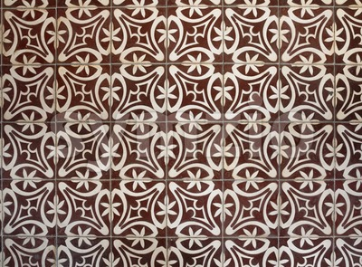 Tiled floor with brown Mediterranean decorations Stock Photo