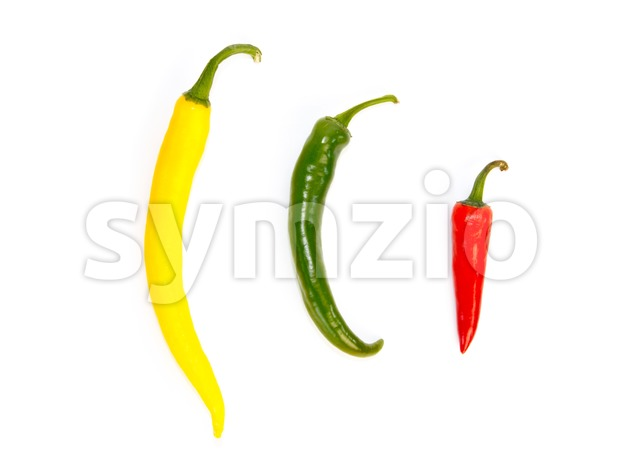 Three peppers in a row in different colors Stock Photo
