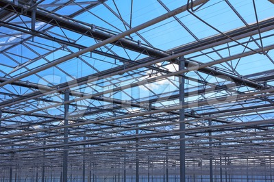Top of the metal structure of a greenhouse Stock Photo