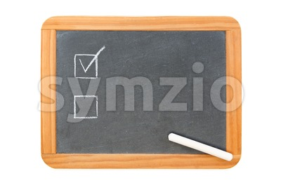Checkboxes on vintage chalkboard and used chalk on the board Stock Photo
