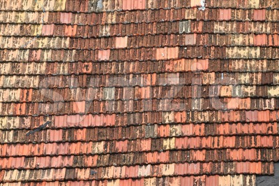 Detail of old roof tiles in uneven colors Stock Photo