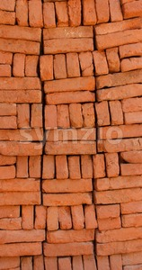 Supply of stacked orange bricks Stock Photo