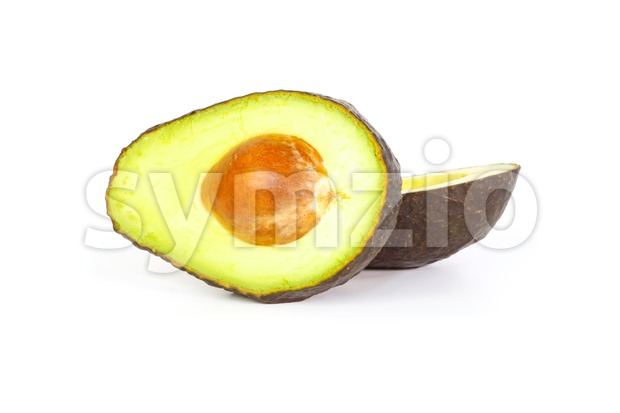 Two halves of avocados against white background Stock Photo
