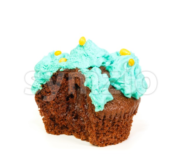 Cupcake with blue frosting of which one bite taken Stock Photo