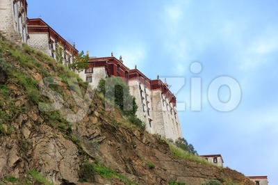 The back of the Potala Palace with a rock face in the front Stock Photo