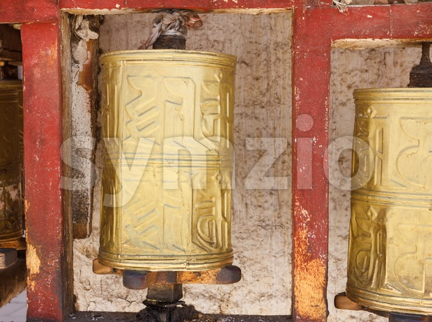 Gold colored Buddhist prayer wheel in Lhasa, Tibet Stock Photo