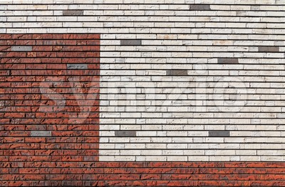 White and orange red brick wall interspersed with some gray bricks Stock Photo