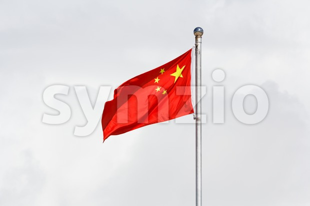Waving Chinese flag against cloudy background Stock Photo