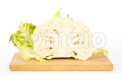 Half a cauliflower on wooden cutting board Stock Photo