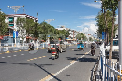 Traffic on the Jiangsu Road in Lhasa, Tibet Stock Photo