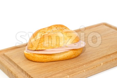 German bread roll with mortadella on breakfast tray Stock Photo