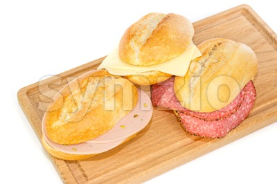 German bread rolls with mortadella, cheese and pepper cervelat Stock Photo