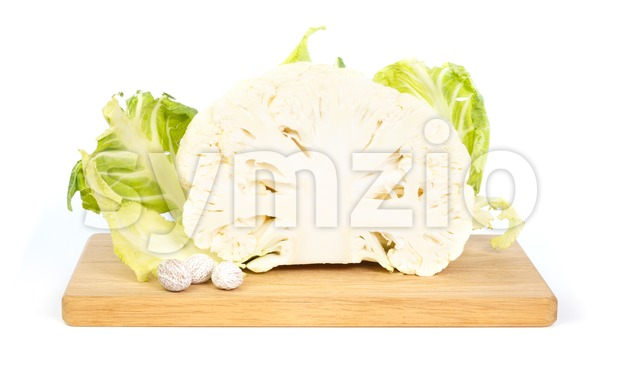 Cauliflower and nutmeg  on a chopping board Stock Photo