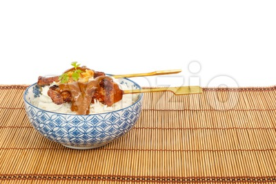Grilled pork satay and rice against white background Stock Photo