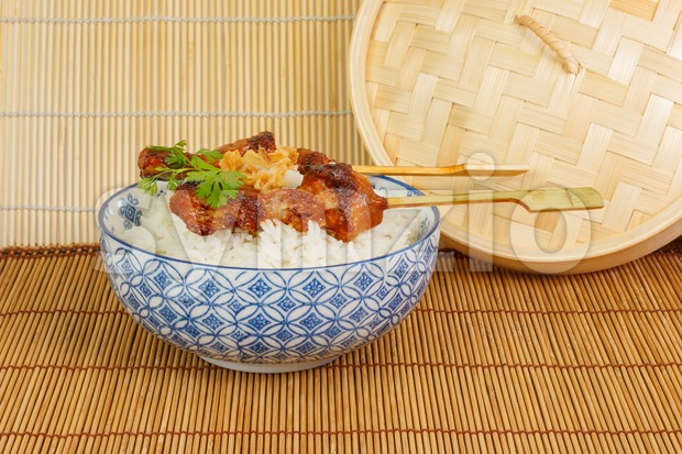 Barbecued pork satay with rice and fried onions Stock Photo