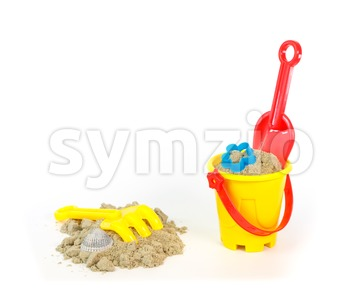Rake, shovel and bucket with a little sand Stock Photo