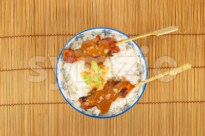 Top view of a bowl of rice with pork satay Stock Photo