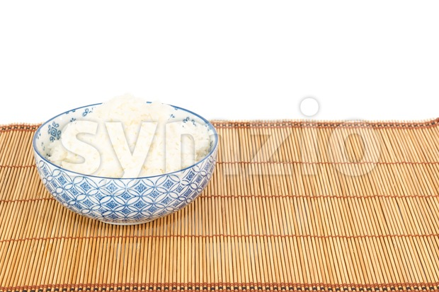 Bowl of rice on placemat in Asian style Stock Photo