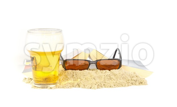 Leisure time on the beach with a book and a beer Stock Photo