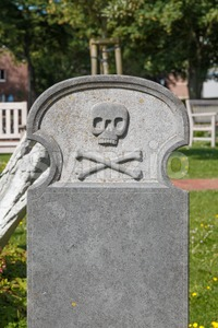 Blank tombstone with skull and crossbones Stock Photo