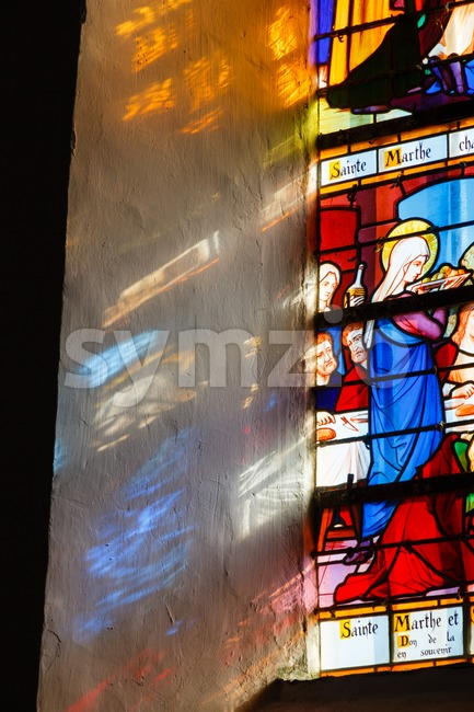 Stained glass window depicting Martha of Bethany in France Stock Photo