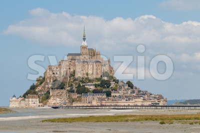 Bridge with tourists walking to Le Mont Saint-Michel Stock Photo