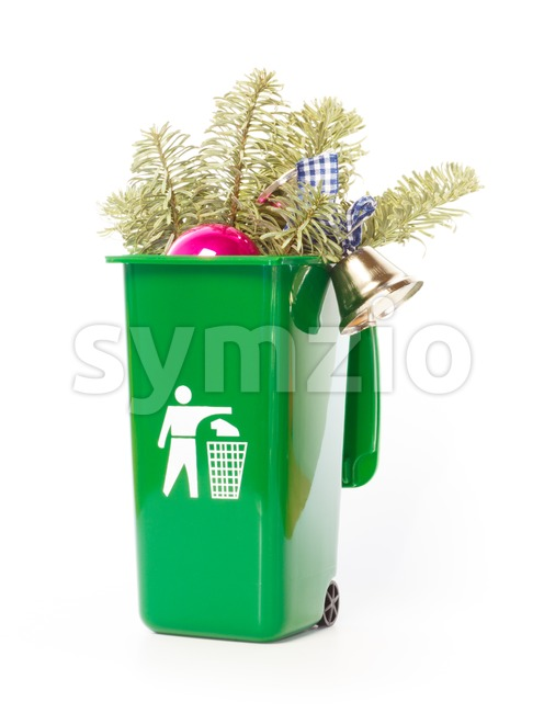 Christmas tree in the green wheelie bin Stock Photo